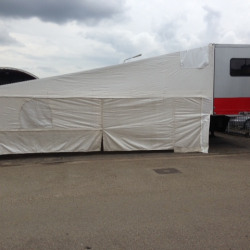 1408107979race trailer with white awning.JPG